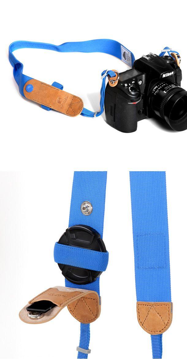 Camera strap with lens cap holder