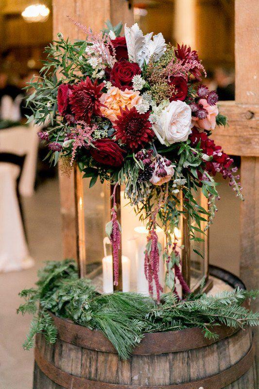 Rustic wedding ceremony decor idea - lantern wedding decor with red, white + greenery bouquet on wine barrell  {Fresh Designs Florist}