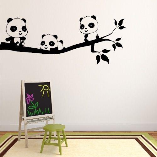 Väggdekor med 3 söta pandor på en gren