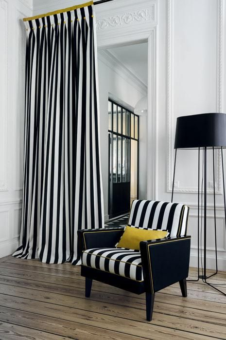 Casamance, Riva Collection - this is a really statement fabric which looks amazing as a long curtain in an otherwise understated scheme. We love the splash of yellow! Available at James Brindley.