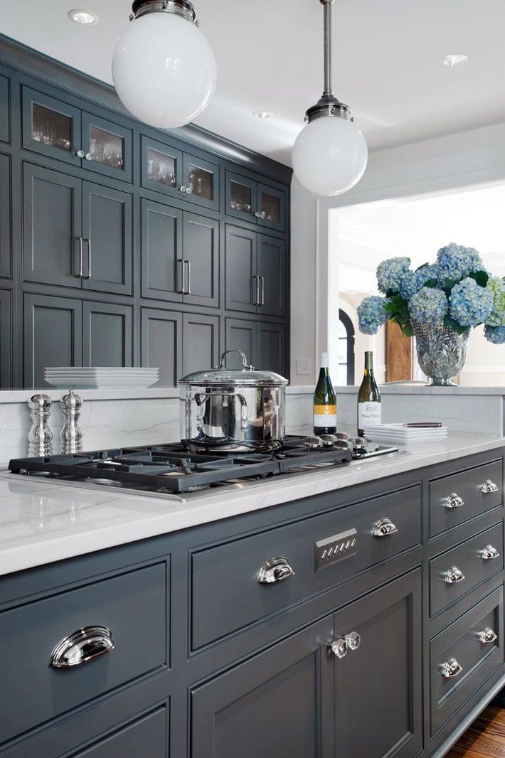 Blue cabinets with glass knobs, chrome pulls and chrome handles - I would paint the top cabinets white
