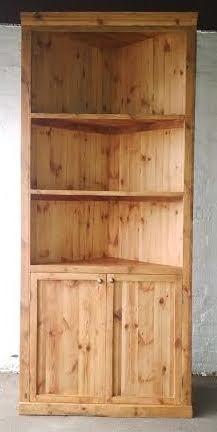 SOLD! #NorthcliffAntiques Corner bookshelf/ display unit. Wood: Mixture of reclaimed wood. Finish: Clear, matt varnish. Bookshelf details: Moulded cornice above three shelves, the lower section with two doors enclosing a single shelf, the handles unadorned and a plinth base.  #Johannesburg #Library #Furniture #Wood #OregonPine #Custom #Built #Bespoke