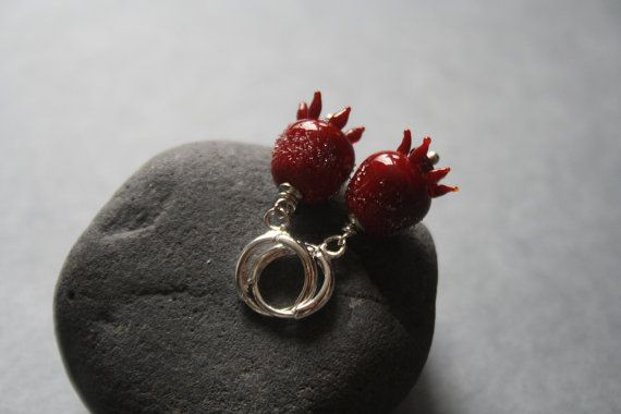 Sugar pomegranate glass earrings. Fittings made by hypoallergenic alloy silver color. 100% lampwork handmade glass. Each…