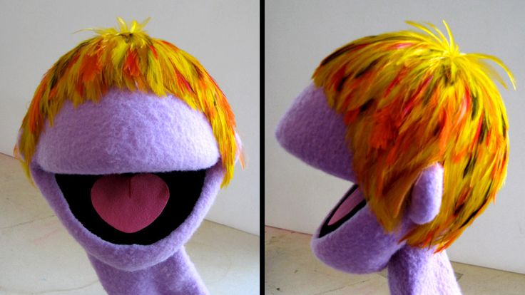 FEATHER WIG: Jim Henson Creature Shop.