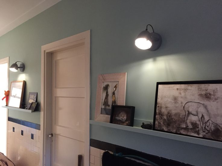 Cool hallway in 1930 house. I painted the walls and the ikea photo racks in the same light teal green color. The industrial  concreet lamps make it absolutely awesome