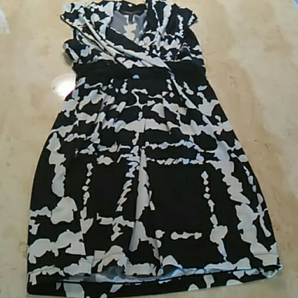 BCBG Maxazria dress petite Black and white print jersey dress. Chic beautiful black and white print jersey knit dress drapes beautifully over your figure  - day into night dress just change accessories. This is a petite - too small for me - reposh. BCBGMaxAzria Dresses
