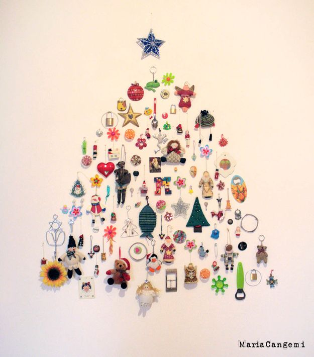 For a more kitschy decor, hang a bunch of knickknacks in the shape of a tree on the wall. | 38 Fabulous DIY Christmas Trees That Aren't Actual Trees