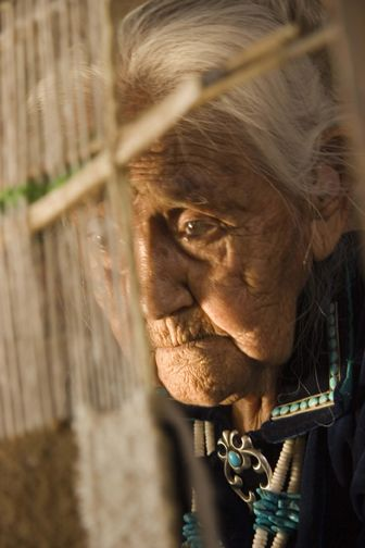the sad thoughtfulness and precision of a Native American weaver in Arizona...