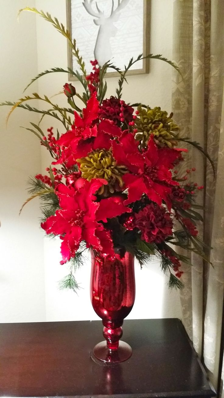 17 best ideas about christmas floral arrangements on for Poinsettia arrangements