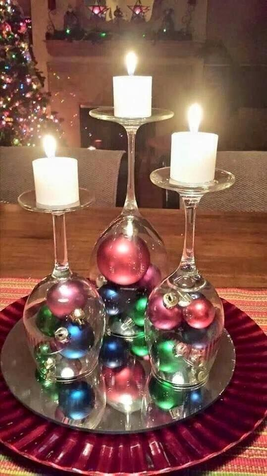 DIY Upside Down Wine Glasses With Small Christmas Ornaments In Bottom And Candles On Top.