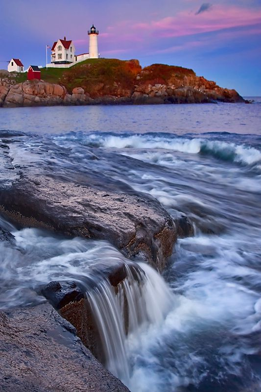 Seaside Waterfall at Nubble Lighthouse, York Maine.   - Explore the World with Travel Nerd Nici, one Country at a Time. http://TravelNerdNici.com
