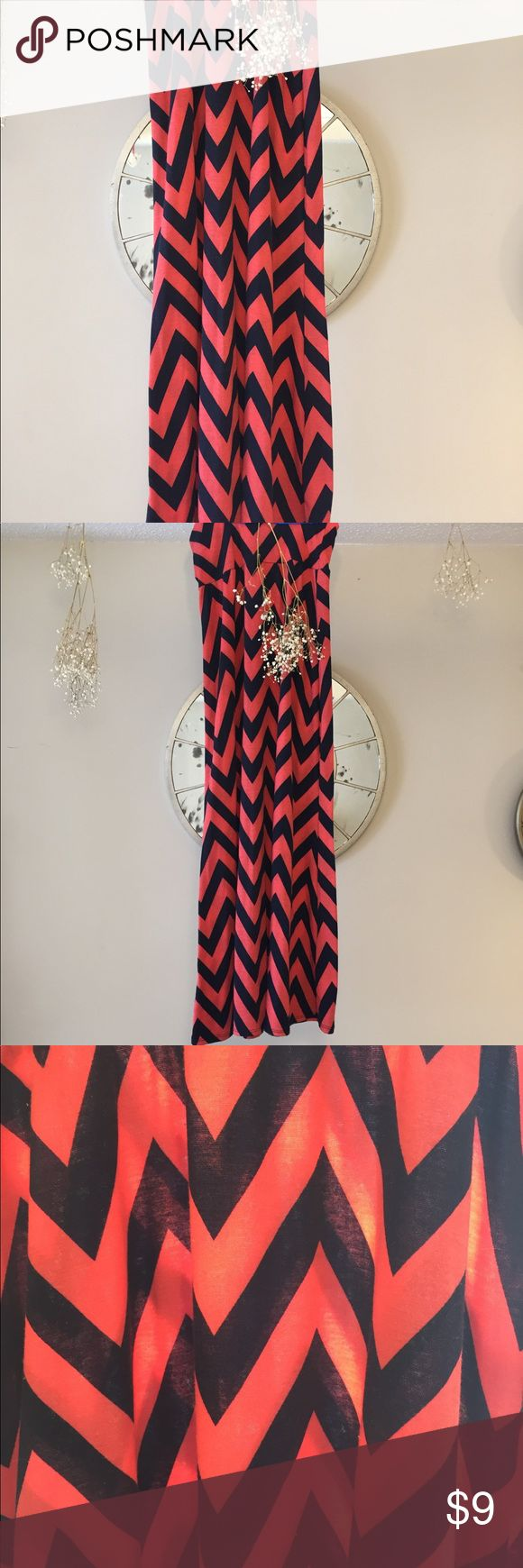 "Beautiful coral and Navy Maxi skirt Beautiful coral and navy maxi skirt. Size small. Fits 5ft through 5'9"". Soft lovable material. Skirts Maxi"
