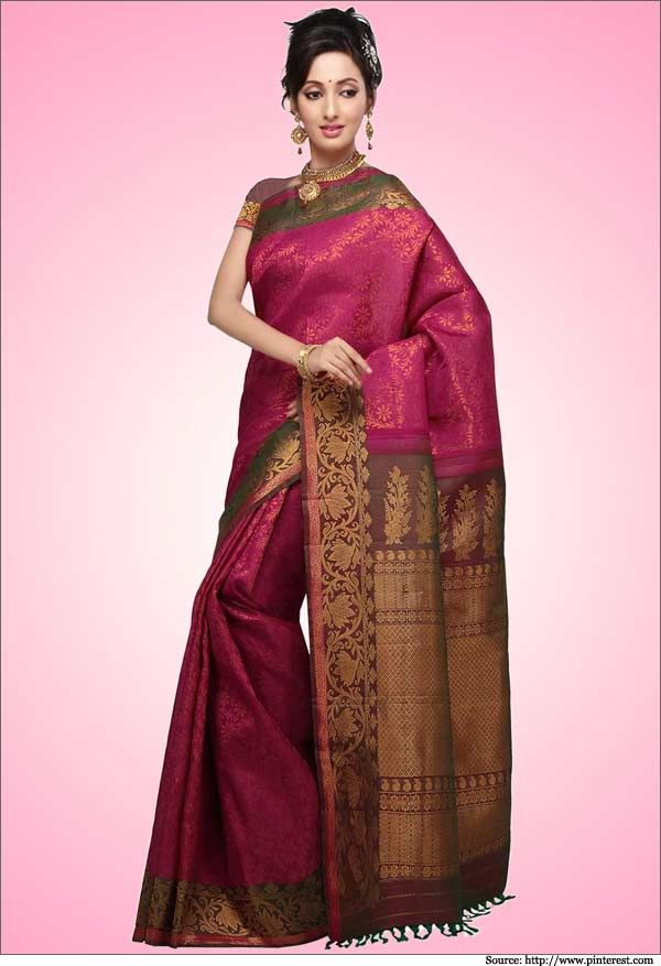 Dark pink handloom gadwal silk saree with zari work all over and a rich border and pallu.  #gadwalsilksarees #sarees