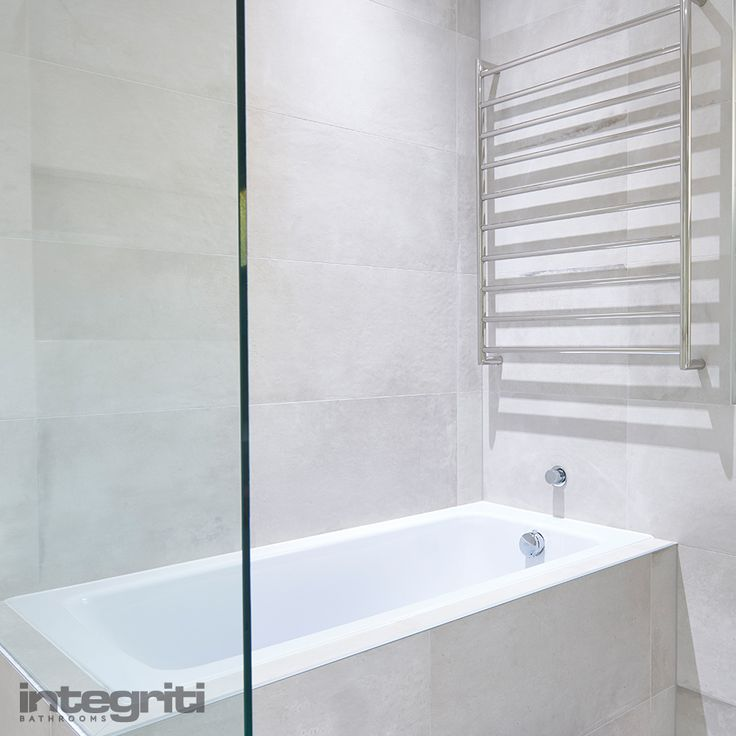 If you're working with a small room, a towel rack can be an efficient use of wall space. Not only can towel racks add a bit of modern flair to your bathroom but they're obviously very practical as well.  #integritibathrooms #custommade #sydneybathroom #interiordesign #bathroom