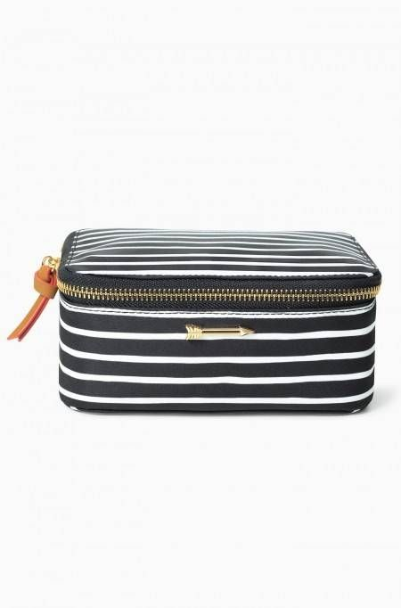 """Stay organized and avoid tangles with the Travel Jewelry Box. Adorn your dresser with the classic black/ cream stripe print, then throw it in your bag for a weekend away full of outfit changes.    Measurements: 3"""" Height x 6 5/8"""" Length x 4 5/8"""" Depth  Exterior: Woven wipeable fabric  Hardware: Shiny gold signature Stella"""