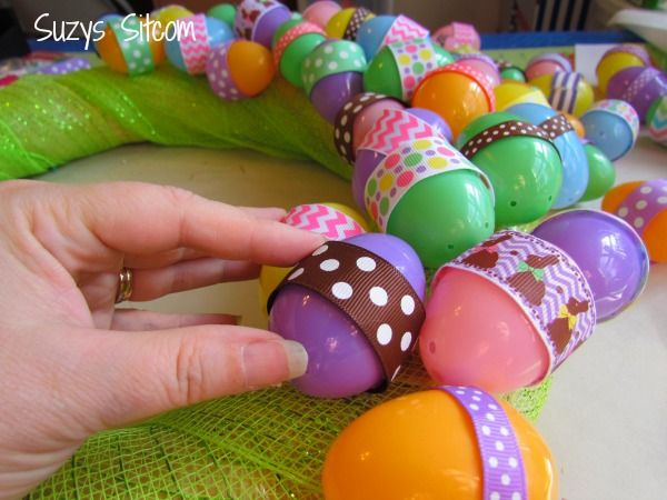 Wrap plastic eggs with multicolored ribbon to create a gorgeous Easter wreath.