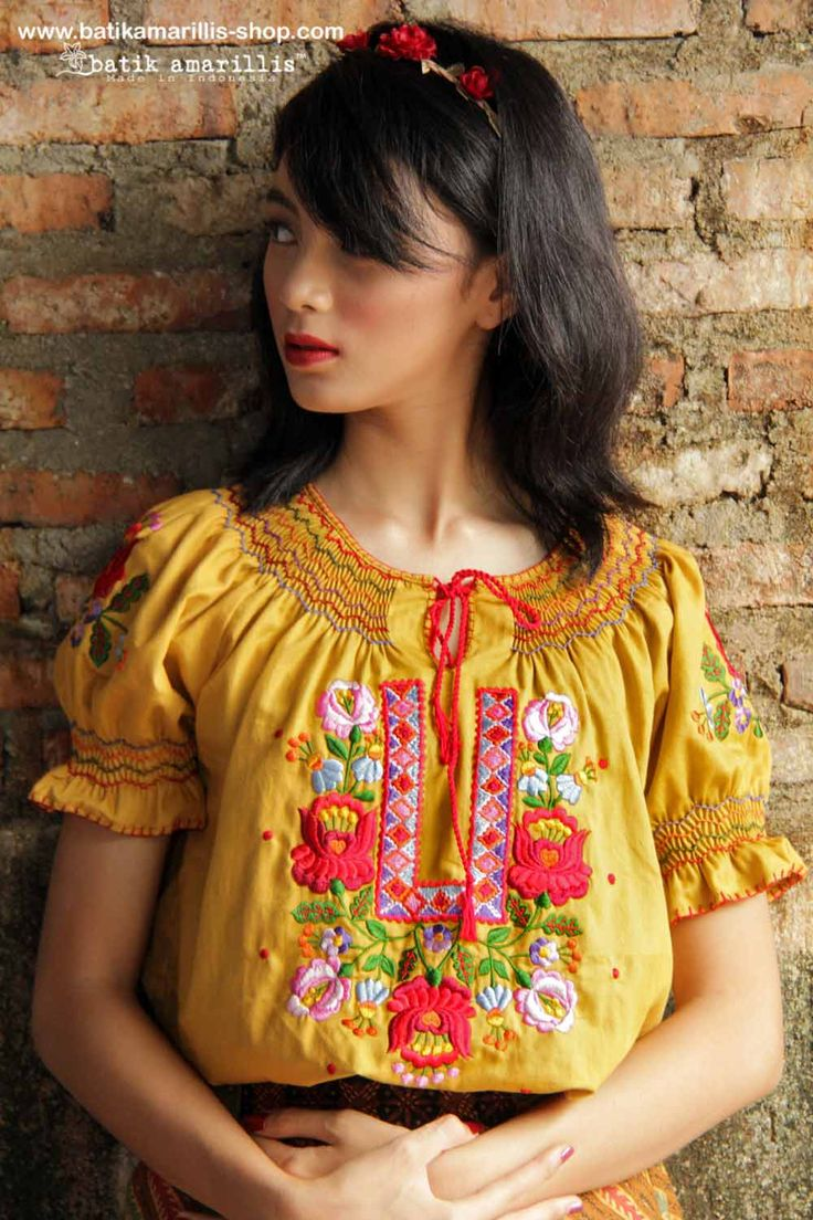 Batik Amarillis's batik amarillis's folklore blouse This beautiful and timeless smocking with Hungarian embroidery is Forever in style as it's always stay romantic, classy and classic, such a keeper of the heart and style.