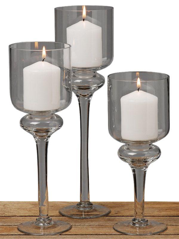 Setul de pahare Ina vă va pune în evidenţă lumânările în orice împrejurare. Setul conţine trei pahare de sticlă cu picior, de înălţime cuprinsă între 25 şi 35 cm. Acest produs se pretează pentru a decora orice masă din cadrul unui eveniment sau poate fi folosit în aranjamentul decorativ al caminului propriu.
