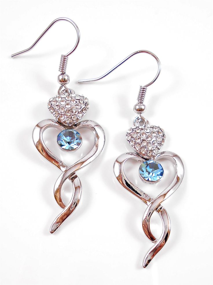 Heart shape earrings with beautiful crystal centre.