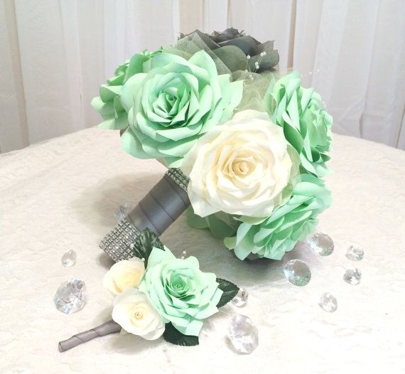Elegant handmade filter paper roses in mint green, ivory and grey. Can be made in colors of your choice. Mixed in the flowers are delicate pearl sprays and shimmering ivory tulle. The stems are wrapped in grey satin ribbon with rows of silver rhinestone mesh ribbon around the top and bottom for extra sparkle.