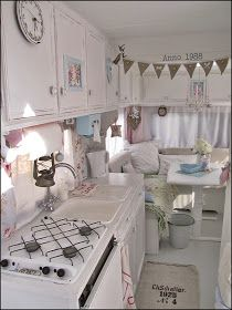 Home Sweet Motorhome: This family took this old, ugly RV from drab to fab! Painting everything white made a huge difference! Love the linens and pastels they used. I want to do this. Find an old eye sore for cheap and completely redo it. Home away from home. ;)
