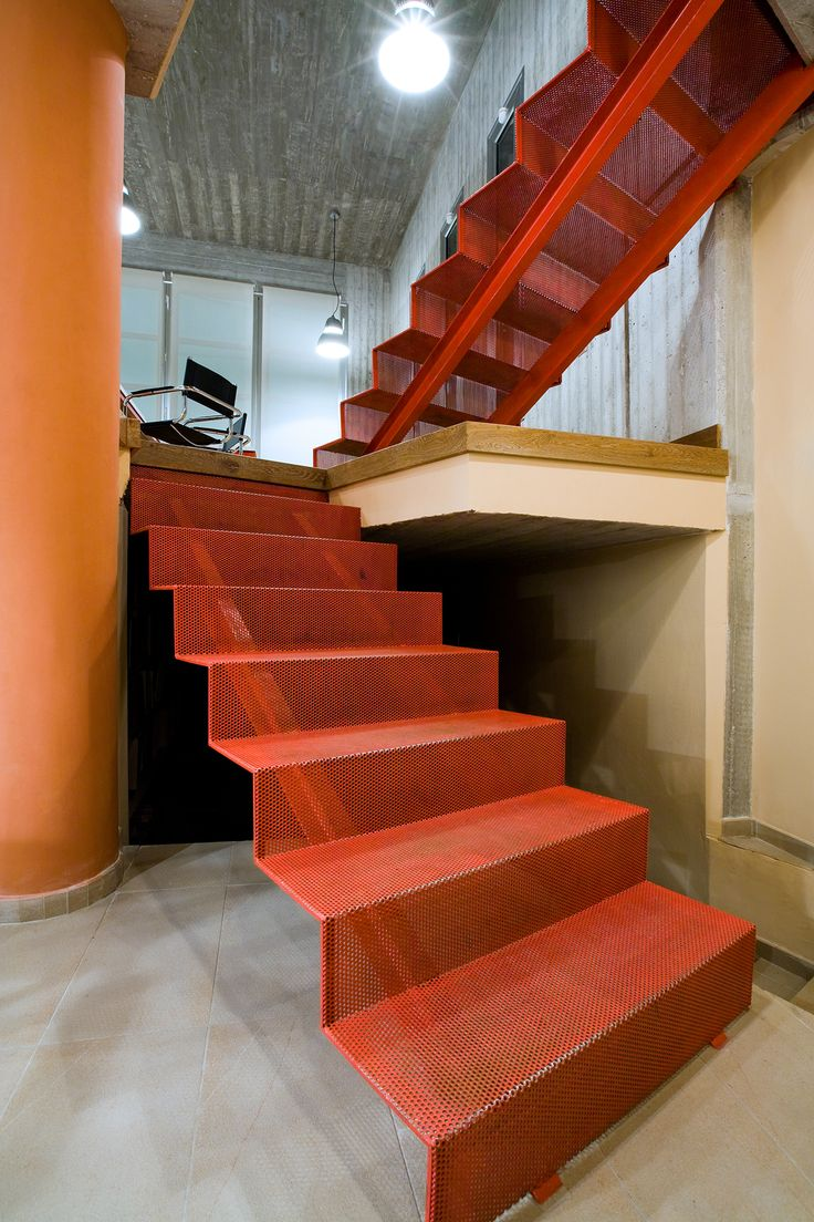 Minimal, industrial, orange, steel stairs found in Watertron Offices, designed and constructed in 2005 by AkPraxis.  To see the whole project visit http://www.akpraxis.gr/portfolio/ak-praxis-offices/