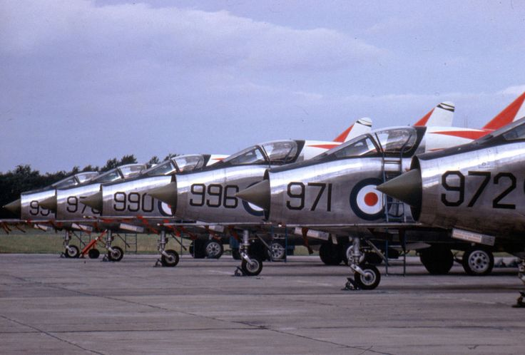 226 OCU, English Electric Lightning T.4 XM972 & line at RAF Middleton St George in 1964. Other aircraft include XM971, XM996, XM990 & XM976