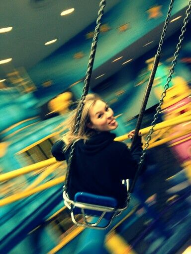 Enjoying the swings at Galaxyland in West Edmonton Mall in Edmonton, Alberta