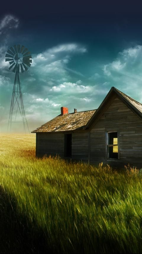 Aged with beauty, old rustic farm house with windmill.