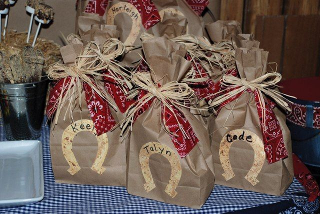Paper bag favors at a Cowboy birthday party!  See more party ideas at CatchMyParty.com!