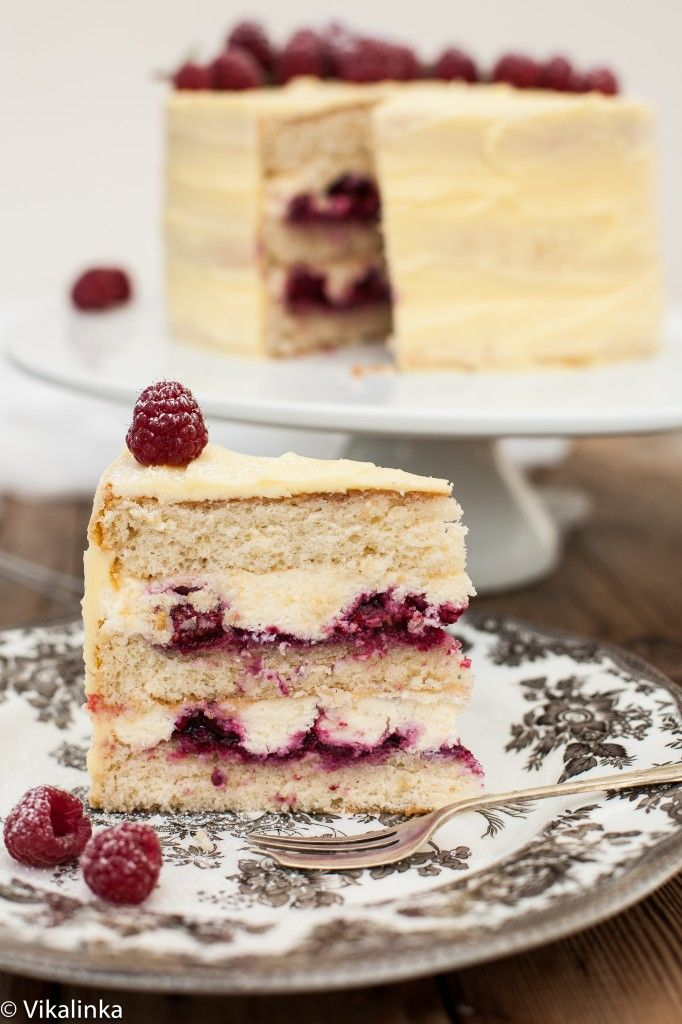 Vanilla cake layers filled with mascarpone cream and raspberry compote and covered with white chocolate buttercream.