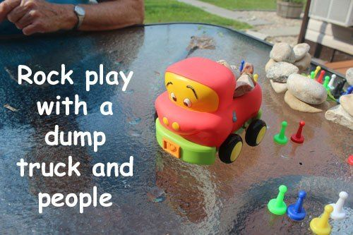 Rock Play with a dump truck and people