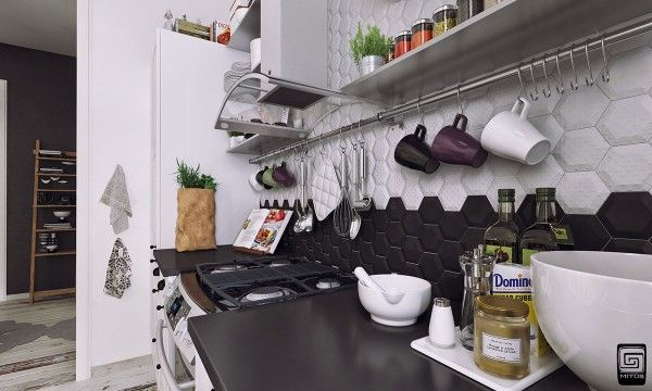On aime beaucoup l'effet du contraste des tuiles monochromes de ce dosseret de cuisine.
