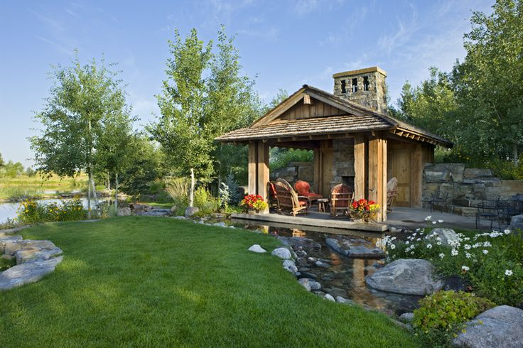 Covered patio on opposite end of pond. Builder: Schlauch Bottcher Construction Interior Design: Locati Interiors Photography: © Roger Wade Studio