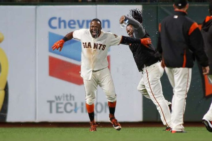 June 27: The San Francisco Giants' Denard Span celebrates with teammates after hitting a walk-off single in the 14th inning of a 4-3 win over the Colorado Rockies at AT&T Park.