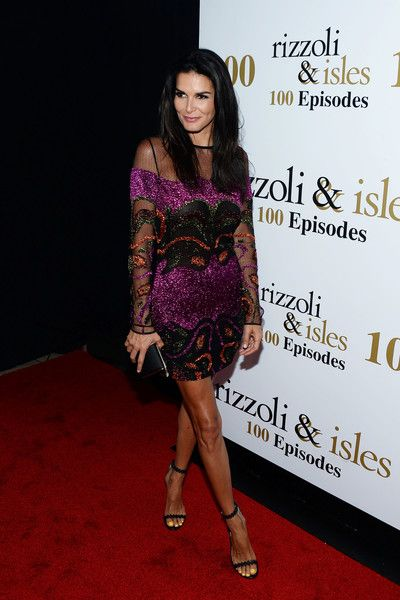 Angie Harmon Strappy Sandals - Angie Harmon polished off her look with elegant black sandals.