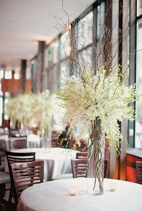 Tables displayed and tall centerpieces of willow branches and freesias. Photo by Elisabeth Millay with Kelly Kollar.