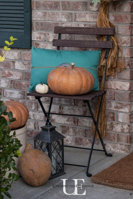 Fall Porch Inspiration Tips: Pumpkins and squash instantly add a touch of fall to your porch and don't cost a lot of money!