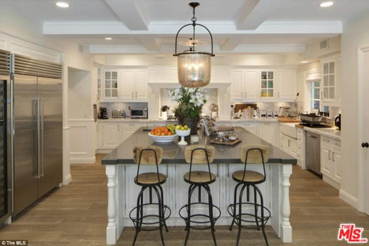 Impressive: The sprawling property boasts an open-plan kitchen and large breakfast bar...