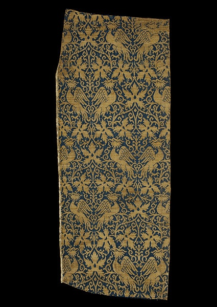 This woven silk is one of the most expensive luxury textiles of the 14th century and might have been used for secular or ecclesiastical dress or furnishings.