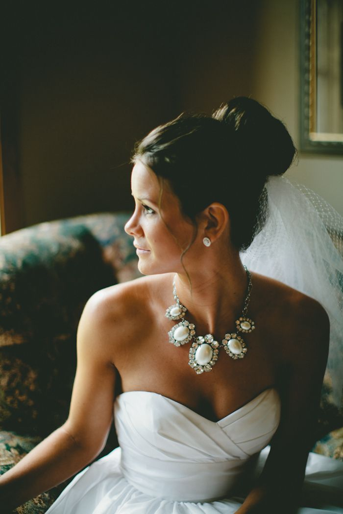Wouldn't do this for my wedding but I still love the high bun, veil and the statement necklace!