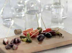 Visit Greece | Tsipouro is produced mainly in Macedonia, Thrace, Epirus, Thessaly, and Crete, it is nevertheless found all over Greece and the pairing with food and especially various hors d'oeuvres (mezedes) is a tradition that every Greek maintains with reverence. #Greece #spirits #aperitif #drinks