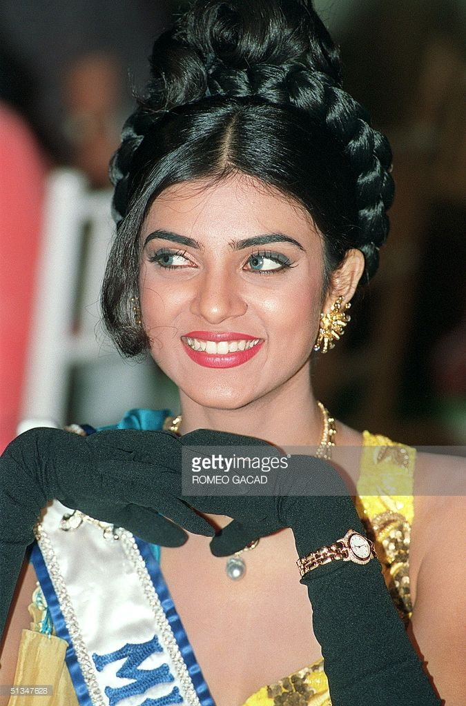 New Miss Universe Sushmita Sen smiles 23 May 1994 during a visit to Malacang Palace to a a courtesy call on Philippine's President, Fidel Ramos in Manila. Sen became the first Indian winner of the world's most prestigious beauty pageant. The 18-year-old model from New Delhi will bring home over 150 000 USD in cash and prizes.