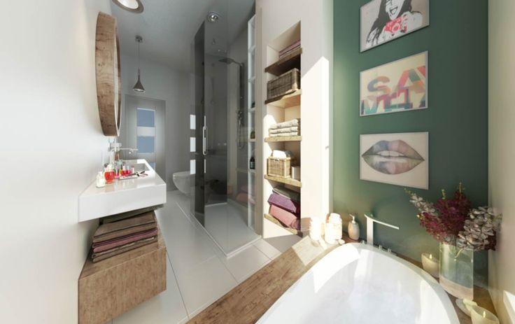 Eelegant gestaltet und mit modernen Details versehen, zum Beispiel einer ebenerdigen Dusche mit gläserner Kabine. Große, helle Bodenfliesen und Wände sorgen für eine freundliche Atmosphäre. Direkt in die Wände eingelassene Regale bieten Stauraum. Und für Entspannung sorgt eine rundum mit edlem Holz verkleidete geräumige Badewanne.