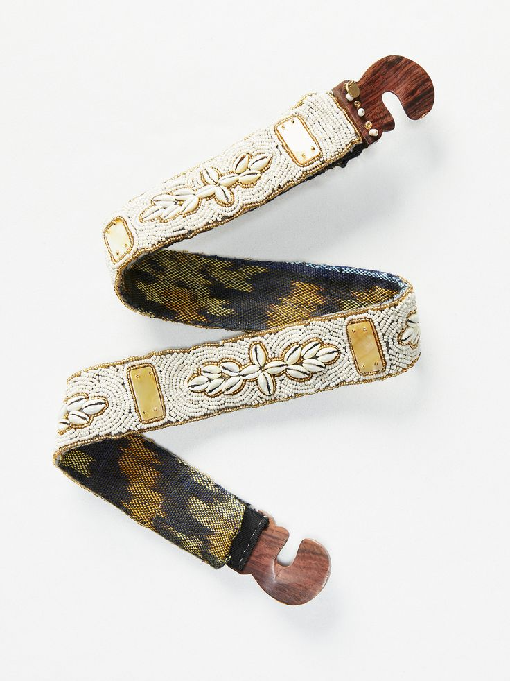 Seychelles Belt | With an island-inspired look, this embellished belt features boho beads and shells with a simple wooden buckle.      * Expands with stretchy elastic bands for the perfect fit