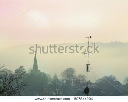 Norwegian town Larvik in the morning mist. Winter of autumn landscape or cityscape.