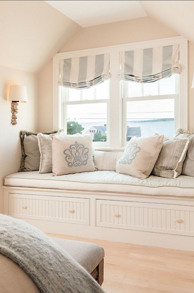 Throw Pillow Ideas. Beautiful pillows in a soft coastal color on a lovely window seat with storage. Great striped relaxed roman shade on window.
