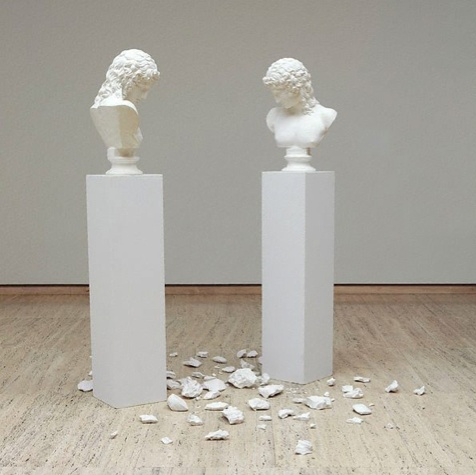 www.mymodernmet.com - This sculpture, titled L'altra figura (The Other Figure) was created by Italian artist Giulio Paolini in 1984. It features two Roman busts raised on plinths, with two mirrored heads looking at the floor as is something dramatic has just taken place. With multiple pieces of plaster shattered onto the floor, it appears that another bust must have taken a great fall to its death.