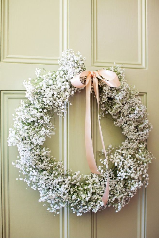 Place wreaths of baby's breath around your venue as a romantic floral arrangement.    As seen in this  Real Wedding.