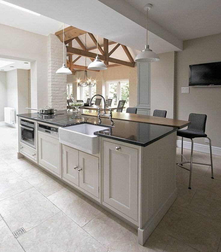 This project includes: timber and stone flooring, farrow & ball colour scheme, lloyd loom furniture, crucial trading rug, hand painted kitchen,utility